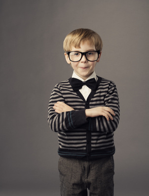 boy in funny glasses, little child fashion studio portrait