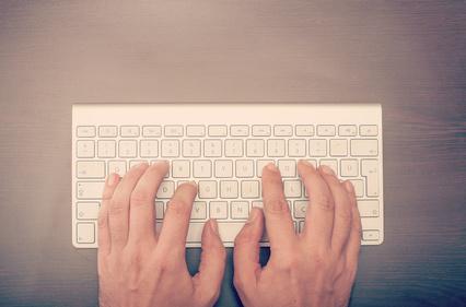 Man typing at the keyboard